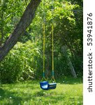 A Child's Swing Sits Empty In...