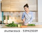 young woman cooking in the... | Shutterstock . vector #539425039