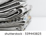 newspapers folded and stacked | Shutterstock . vector #539443825