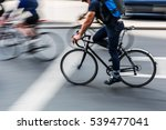 bicycle rider in city traffic... | Shutterstock . vector #539477041