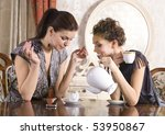 Two Girl Friends Talk And Drin...