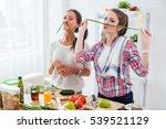 women preparing healthy food... | Shutterstock . vector #539521129