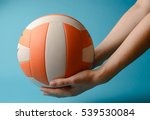 Woman Hold Volleyball In Her...