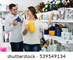 family chooses ceramic ware in... | Shutterstock . vector #539549134