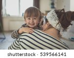 happy toddler boy hugging his... | Shutterstock . vector #539566141