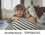 happy toddler boy hugging his... | Shutterstock . vector #539566141