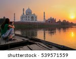 Woman Watching Sunset Over Taj...
