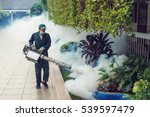 Small photo of Man work fogging to eliminate mosquito for preventing spread dengue fever and zika virus