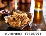 fried chicken tenders in paper... | Shutterstock . vector #539607085