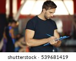 personal trainer holding... | Shutterstock . vector #539681419