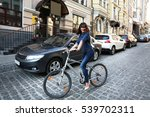 pretty young woman riding bike... | Shutterstock . vector #539702311