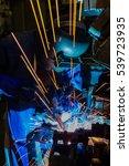 industrial worker is welding in ...   Shutterstock . vector #539723935
