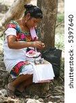 A Mayan Woman Making Decorativ...