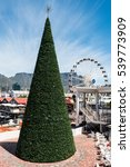 Small photo of Cape Town, South Africa - November 15, 2016: Christmas preparation at the famous Victoria and Alfred (V&A) Waterfront of Cape Town with the Table Mountain in the background: The tree is erected and