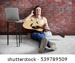 young man playing guitar and... | Shutterstock . vector #539789509