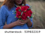 Woman Holding Flowers Bouquet...
