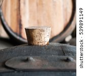 Small photo of Old oak barrels in cellar with cork bung.