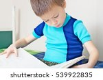 kid reading book on bed ... | Shutterstock . vector #539922835