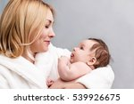 mother embrace her cute baby... | Shutterstock . vector #539926675