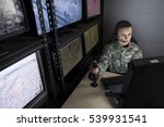Female military drone operator, wide shot - stock photo