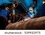 man welds at the factory | Shutterstock . vector #539932975