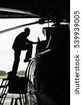 Small photo of Aircraft mechanic, black and white , Inside aerospace hangar