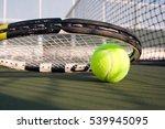 tennis ball and racket on hard...   Shutterstock . vector #539945095