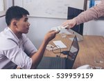 Small photo of Employees accepting bribes while working. Venality, bribe, corruption concept