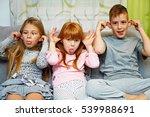 Three Children Making Funny...