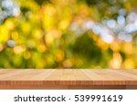 wood shelf on blurred green... | Shutterstock . vector #539991619