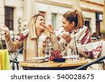 two women in cafe after shopping | Shutterstock . vector #540028675