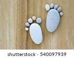 Two Tiny Stone Feet And Ten...