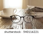 newspapers over wooden table | Shutterstock . vector #540116221