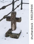 Old Cemetery Cross In Winter...