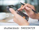 male hands using calculator | Shutterstock . vector #540154729