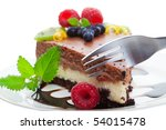 Fork cutting into a double decker chocolate cheese cake, Focus on fork shallow depth of field - stock photo