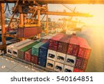 Small photo of container,container ship in import export and business logistic.By crane , Trade Port , Shipping.Tugboat assisting cargo to harbor.Aerial view.