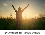silhouette of a man raising his ... | Shutterstock . vector #540169501