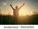 silhouette of a man raising his ...   Shutterstock . vector #540169501