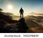 the man standing high on cliff. ... | Shutterstock . vector #540298849