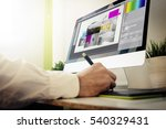 designer designing a layout.... | Shutterstock . vector #540329431