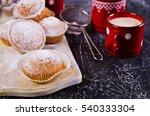 Muffins In Powdered Sugar On A...