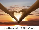 Heart Shape From Hands Against...