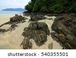 Small photo of rocky beach with amalgamate shell at one of 800 islands in Andaman Sea south of Myanmar