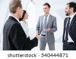 Business People Talk Near The...