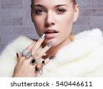 beautiful woman in fur  hands... | Shutterstock . vector #540446611