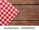 red napkin on wooden table | Shutterstock . vector #540483991