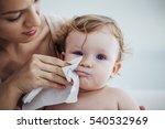 Mother Wiping Baby's Face