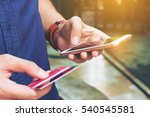 man use smart phone and holding ... | Shutterstock . vector #540545581