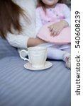toddler girl sitting on mother... | Shutterstock . vector #540608239